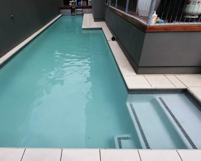 Modern Pool After Concrete Pool Renovations - Luxury Pools